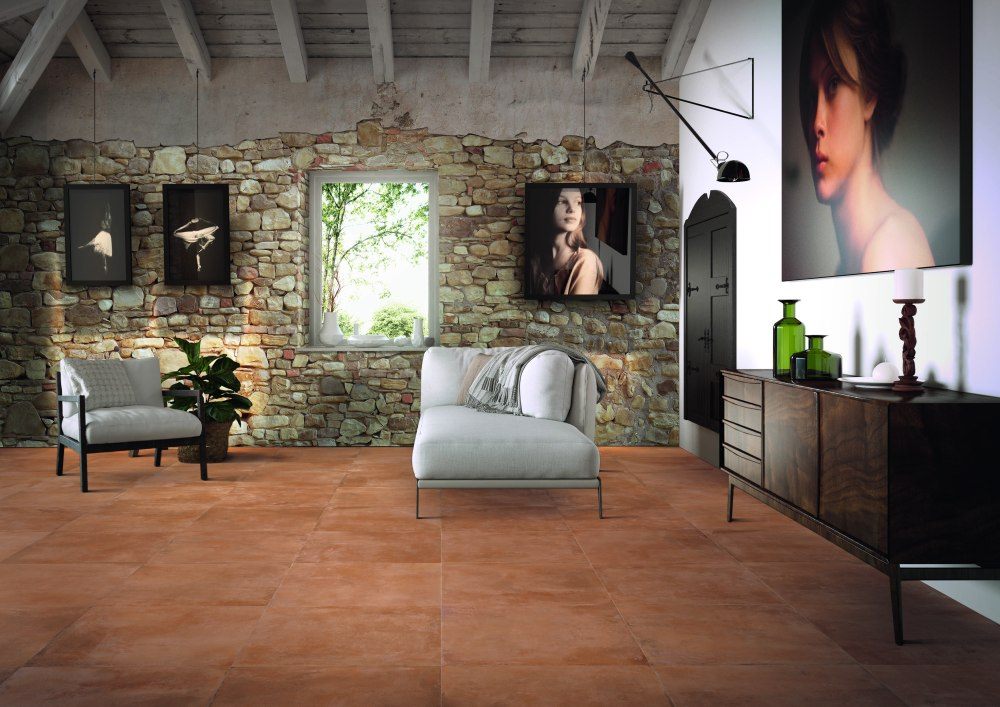 Kakeldaxgruppen-vardagsrum med cotti d'italia på golvet och stenvägg
