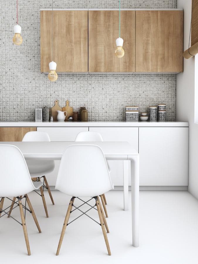 Bild på ett kök. Väggen har en ljus mosaik, skåpsluckorna är delvis i trä och delvis vita. Det finns också ett vitt bord med vita stolar.