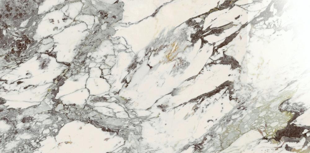 Produktbild med marmorlook. Vit bas med marmorering i olika nyanser av grå och brun